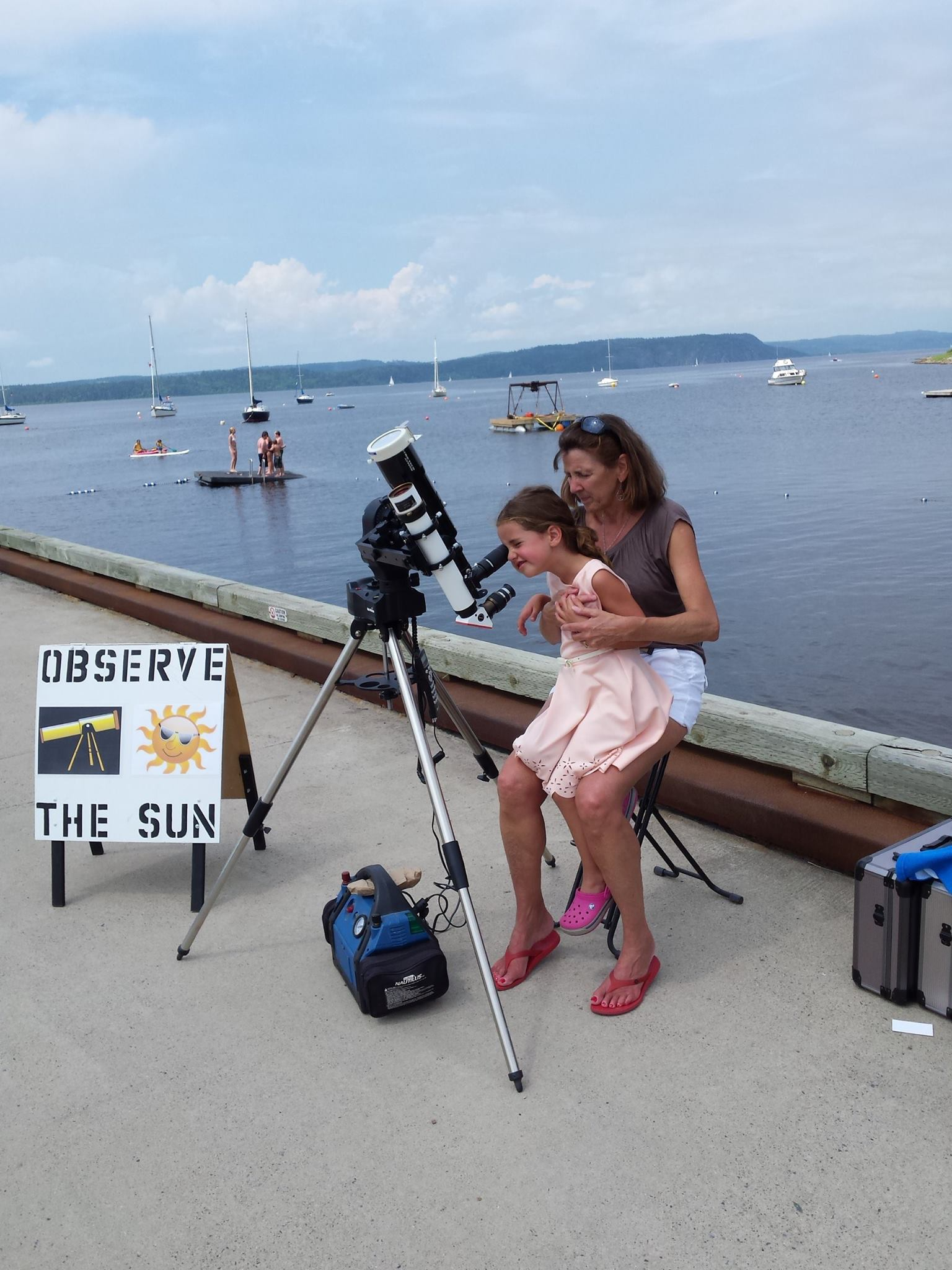 Viewing the Sun safely through a special filteredl telescope.