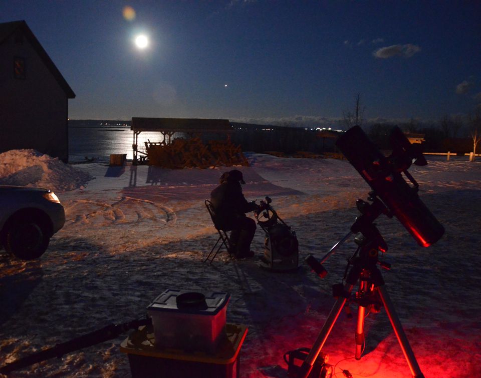 Setting telescopes up by the barn at the Irving Nature Park Moonlight Snowshoe Walk 2017