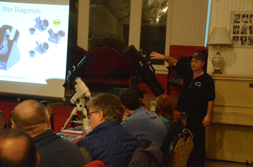 Photograph of Paul Owen showing different types of equipment at astronomy workshop.