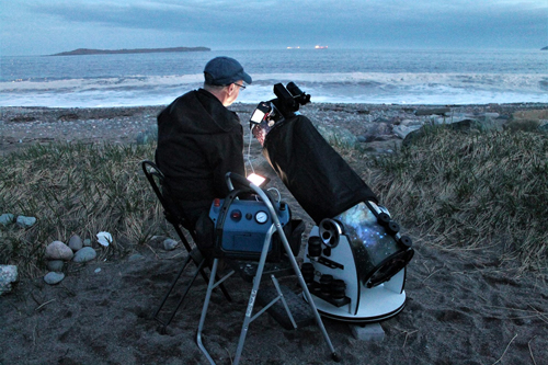 Chris Curwin of Astronomy by the Bay looking at a live feed through a telescope at Saints Rest Beach in Saint John.