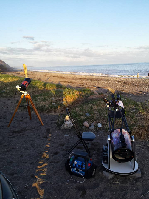 Two telescopes set up for public viewing at Saints Rest Beach in Saint John, NB.