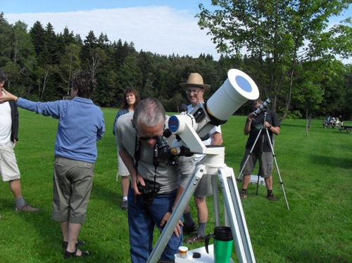 Viewing the Sun through a specially filtered telescope.