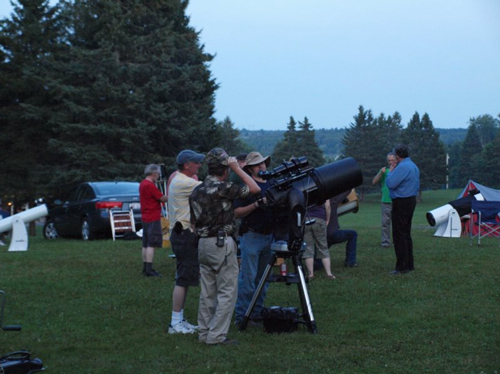 Setting up telescopes at one of New Brunswick's five star parties.