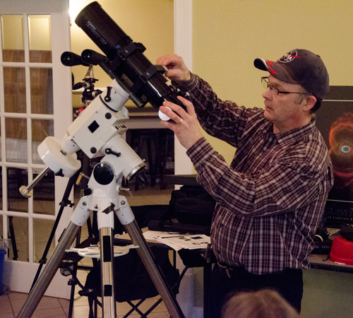 Paul Owen mounting a refractor scope on an equatorial mount.
