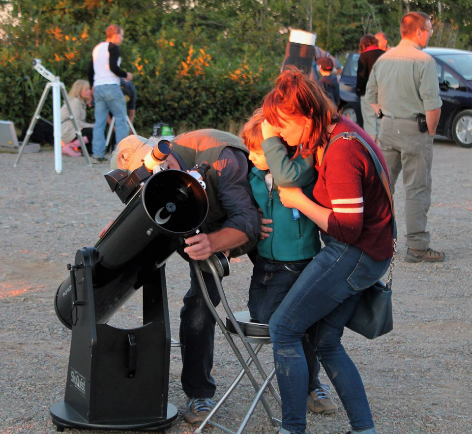 Photo of looking through a telescope at the National Star Party celebrated at Irving Nature Park, Saint John, NB.