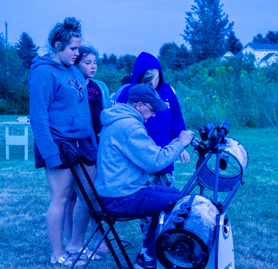 Astronomer Chris Curwin and with the public at twilight--Outreach Event in Norton, NB