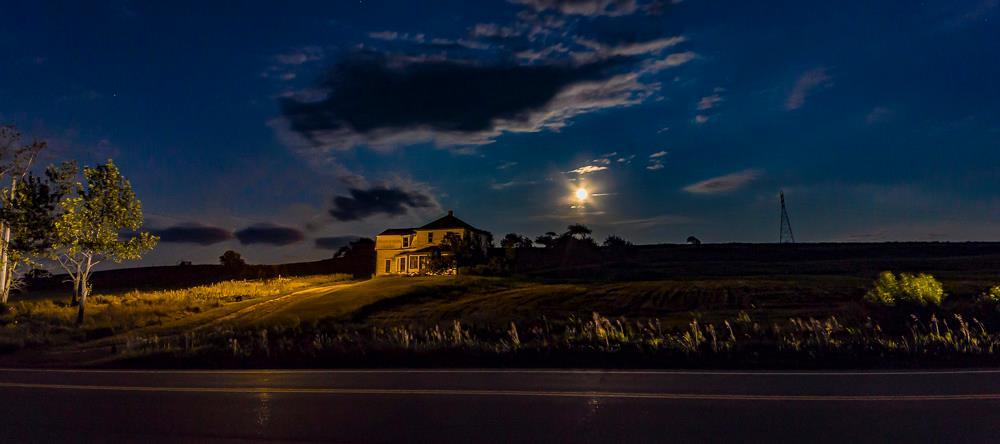 Moon over farmhouse by Paul Owen