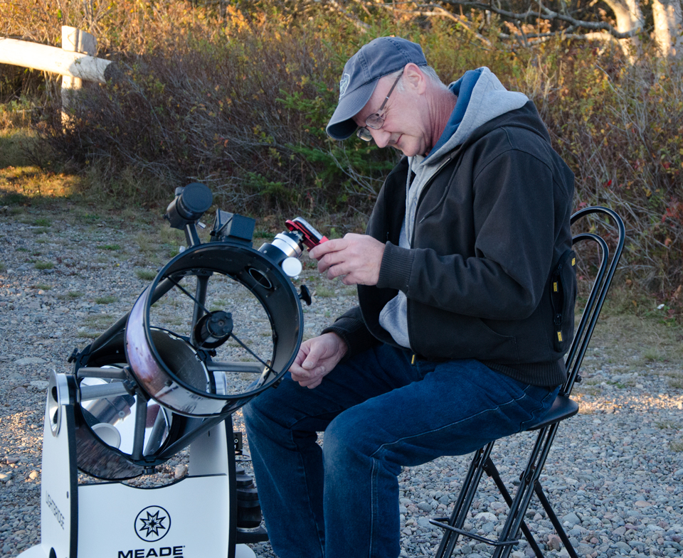 Astronomer Chris Curwin setting up at the Observe the Moon Night October 2017 at Irving Nature Park