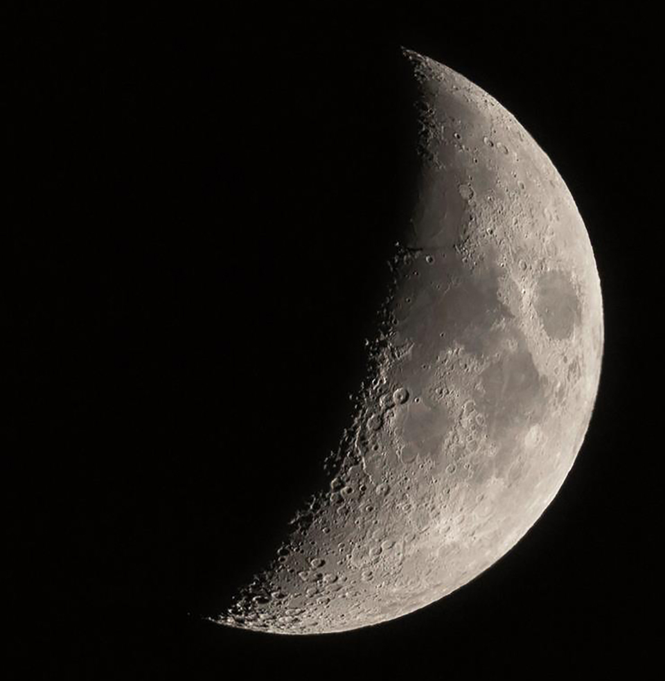 A photo of the crescent Moon by Paul Owen.
