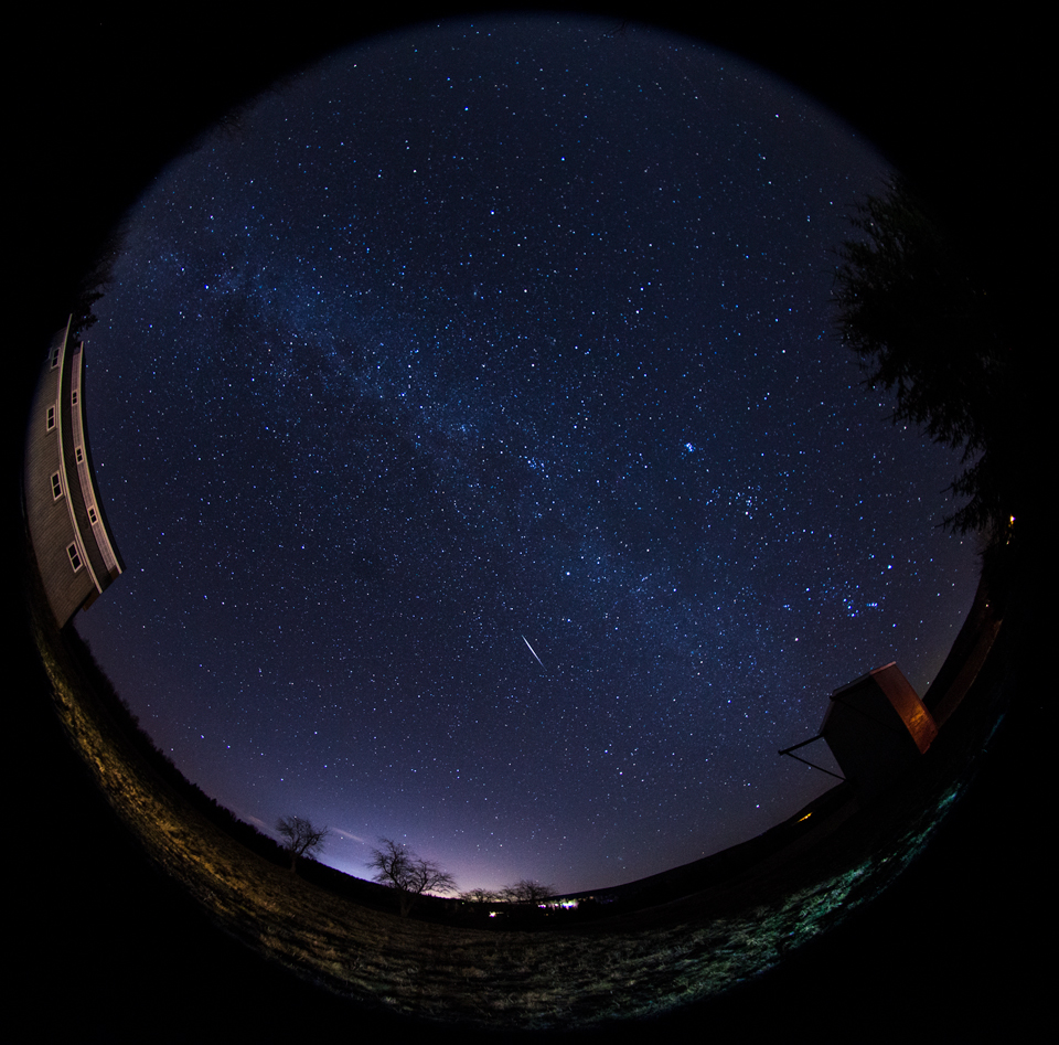 A Geminid Meteor streaks through the sky in rural New Brunswick.