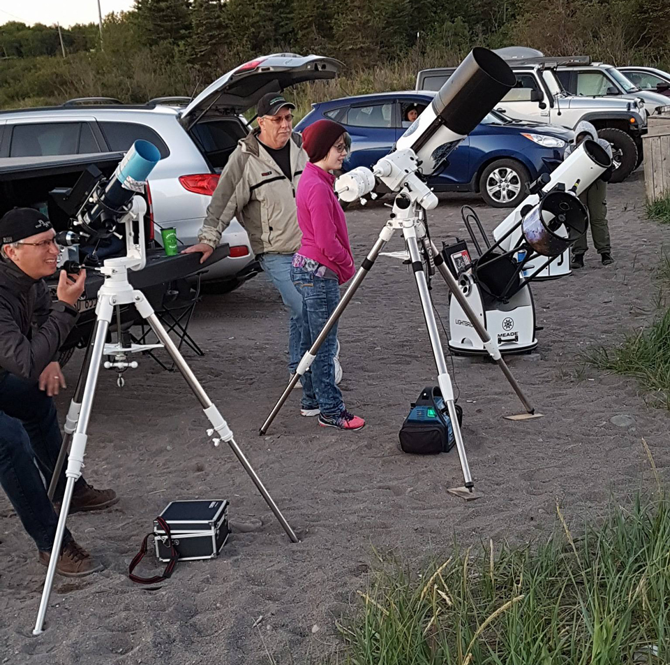 Photo of telescopes set up at Saints Rest Beach, Saint John, NB, for public viewing.