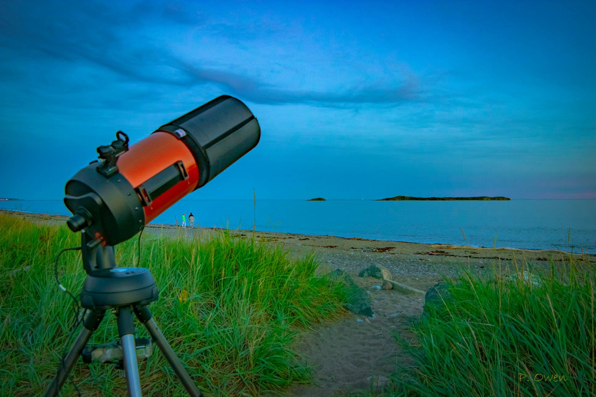 A telescope set up at Saints Rest beach in Saint John, NB waiting for the night sky.