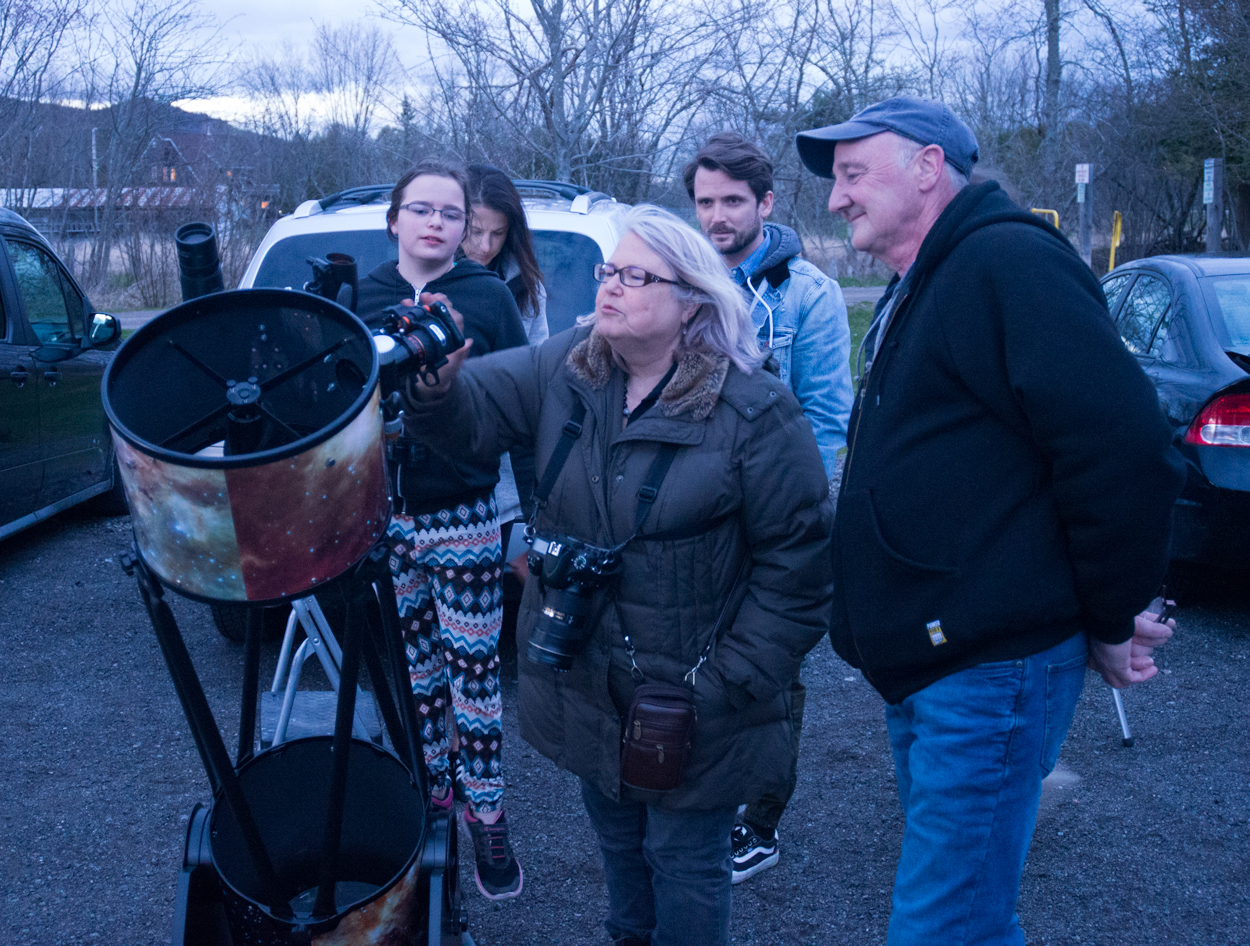 Chris Curwin looking on as someone captures a pic of the Moon with their cellphone at the Hampton Star Party, May 11, 2019 [photo-Jim Stewart]