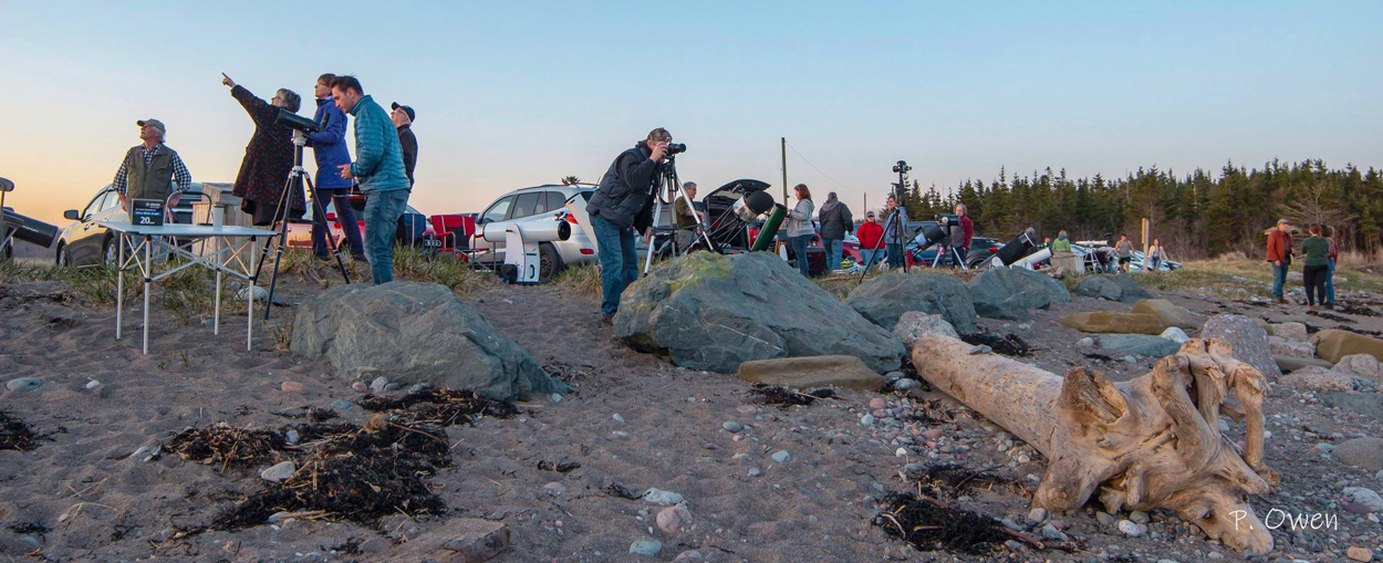Photo showing a group of astronomers from the Saint John Astronomy Club having a Mini Star Party at Saints Rest Beach in Saint John, NB. Photo by Paul Owen
