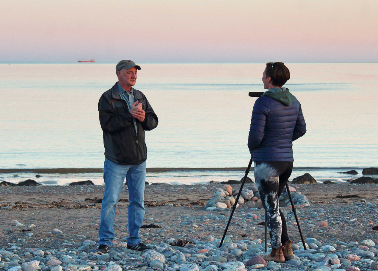 Chris Curwin of Astronomy by the Bay being interviewed by Jenna Hinds of RASC at Saints Rest Beach in Saint John, NB, May 2019. Photo by Trudy Almon.